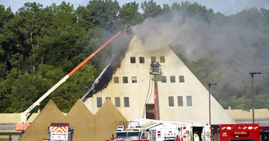 Firefighters Battle Flames At Golden Pyramid House, Rescue Designer