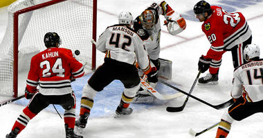 Chicago Blackhawks left wing Brandon Saad (20) scores a goal against Anaheim Ducks goaltender John Gibson (36) and defenseman Josh Manson (42) as center Dominik Kahun (24) looks on during the first period of an NHL hockey game on Tuesday Oct. 23, 2018, in