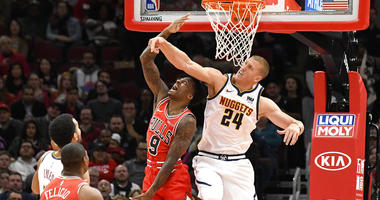 Denver Nuggets forward Mason Plumlee (24) defends against Chicago Bulls guard Antonio Blakeney (9) during the first half of an NBA basketball game Wednesday, Oct. 31, 2018, in Chicago. (AP Photo/David Banks)