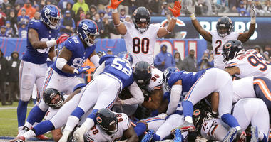 Chicago Bears defensive end Akiem Hicks (96) dives in for a touchdown run against the New York Giants during the first half of an NFL football game, Sunday, Dec. 2, 2018, in East Rutherford, N.J. (AP Photo/Seth Wenig)