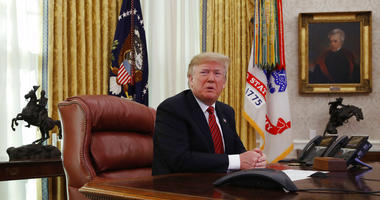 President Donald Trump answers questions from the media after speaking with members of the military by video conference on Christmas Day, Tuesday, Dec. 25, 2018, in the Oval Office of the White House. (AP Photo/Jacquelyn Martin)