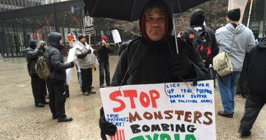 The U.S., British and French bombing raids in Syria prompted about 35 activists to gather in Federal Plaza.