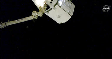 In this image taken from NASA Television, the SpaceX Dragon cargo spacecraft is captured by a robotic arm for docking to the International Space Station, Saturday, Dec. 8, 2018.
