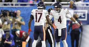Chicago Bears quarterback Chase Daniel (4) celebrates with defensive back Sherrick McManis (27)