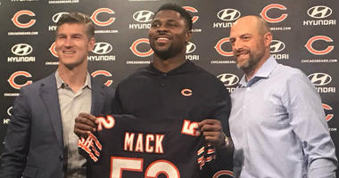 Khalil Mack with Bears General Manager Ryan Pace (l) and head coach Matt Nagy.