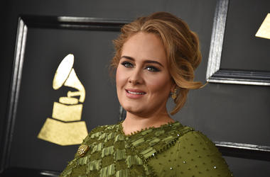 Adele arrives at the 59th annual Grammy Awards