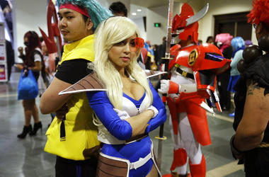 "participants at Anime Boston, Threa Srey, of Lowell, Mass., left, dressed as Bulma from the Japanese animated series ""Dragon Ball Z,"""
