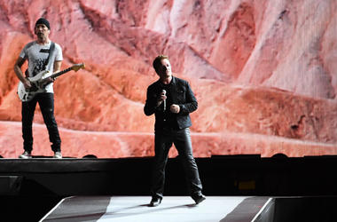 Bono and The Edge of U2 performs at Hard Rock Stadium.