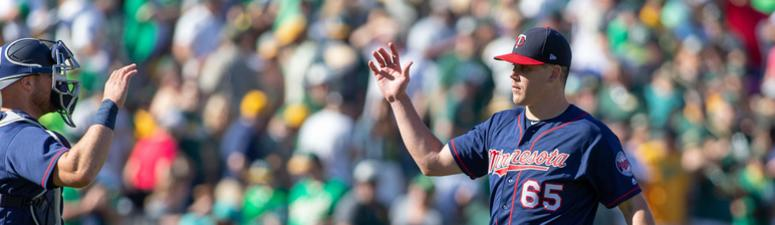 Trevor May gets a high-five from Chris Giminez