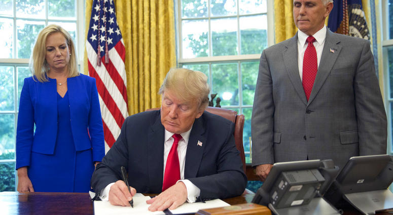 In reversal, Trump signs order stopping family separation