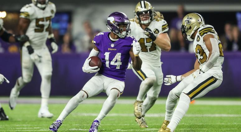 Stefon Diggs tries to get by Saints defense
