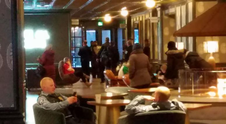 Officers in hotel lobby during standoff