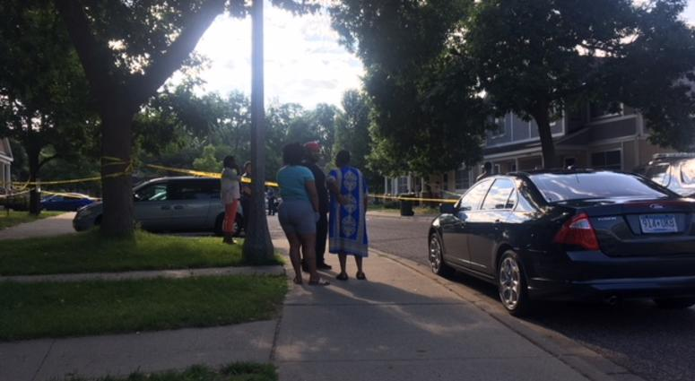 Family members gather at the scene of the suspicious death