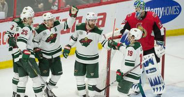 A goal is celebrated by Zach Parise and the Wild