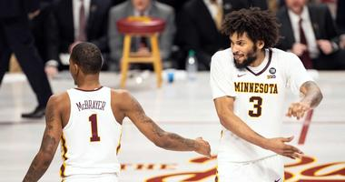 DuPree McBrayer and Jordan Murphy celebrate for the Gophers