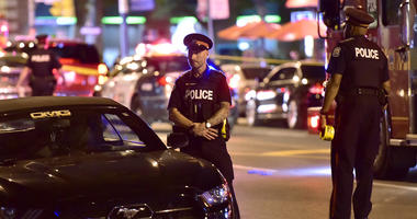 Man firing into Toronto cafes shoots 14 people, killing 2
