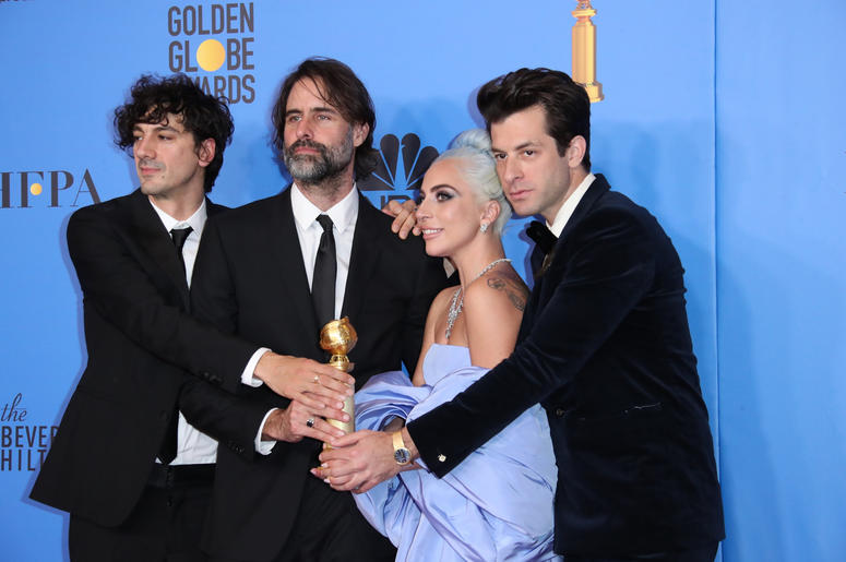 "Anthony Rossomando, from left, Andrew Wyatt, Lady Gaga and Mark Ronson pose in the press room with the award for best original song, motion picture for ""Shallow\"" from the film \""A Star Is Born\"" at the 76th"