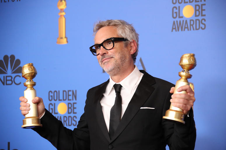 "Alfonso Cuaron poses in the press room with the awards for best director, motion picture and best motion picture, foreign language for ""Roma\"" at the 76th Golden Globe Awards at the Beverly Hilton."
