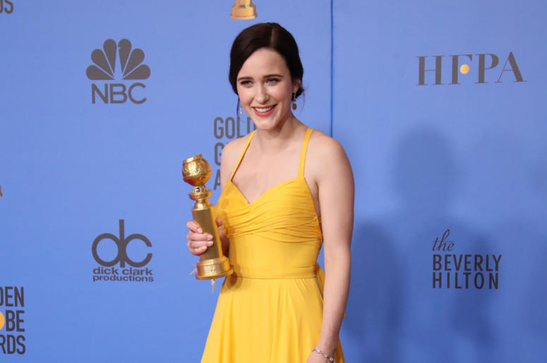 "Rachel Brosnahan poses in the press room with the award for best performance by an actress in a television series, musical or comedy for ""The Marvelous Mrs. Maisel\"" at the 76th Golden Globe Awards"