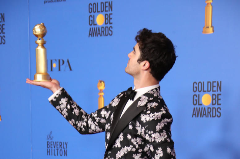 "Darren Criss poses in the press room with the award for best performance by an actor in a limited series or a motion picture made for television for ""The Assassination of Gianni Versace: American Crime Story\"" at the 76th Golden Globe Awards at the Bever"