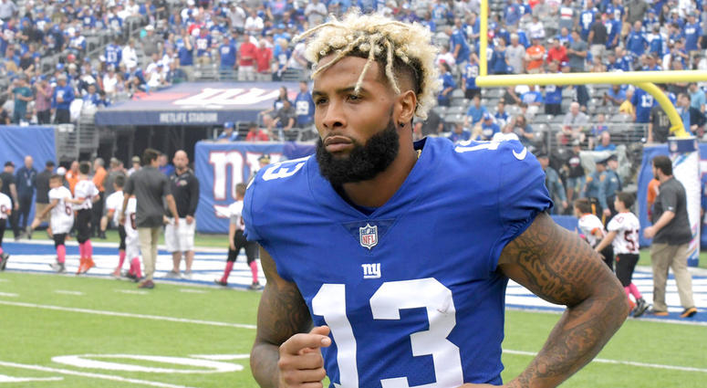 FILE - In this Oct. 8, 2017, file photo, New York Giants wide receiver Odell Beckham warms up prior to an NFL football game against the Los Angeles Chargers, in East Rutherford, N.J. The Giants have opened their first organized team activities under new c
