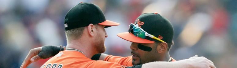 Baltimore Orioles starting pitcher Alex Cobb, left, and Jonathan Villar hug after the Orioles defeated the Cleveland Indians in a baseball game, Saturday, Aug. 18, 2018, in Cleveland.