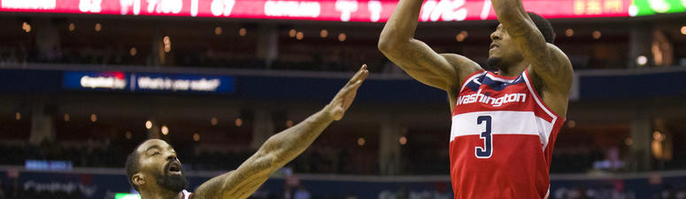 Washington Wizards guard Bradley Beal (3) shoots over Cleveland Cavaliers guard J.R. Smith (5) during the second half of an NBA basketball game Wednesday, Nov. 14, 2018, in Washington. The Wizards won 119-95. (AP Photo/Alex Brandon)