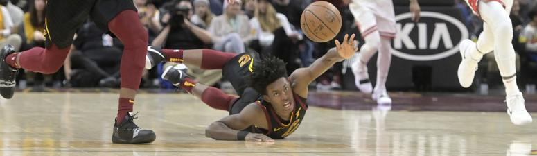 Jan 21, 2019; Cleveland, OH, USA; Cleveland Cavaliers guard Collin Sexton (2) taps the ball to forward Jaron Blossomgame (4) in the second quarter against the dChicago Bulls at Quicken Loans Arena. Mandatory Credit: David Richard-USA TODAY Sports