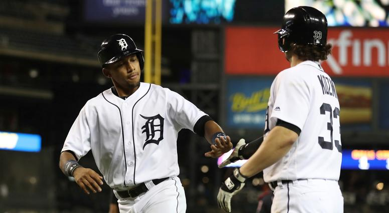 Detroit Tigers' Dixon Machado is congratulated by Pete Kozma after scoring during the seventh inning of a baseball game against the Cleveland Indians, Tuesday, May 15, 2018, in Detroit.