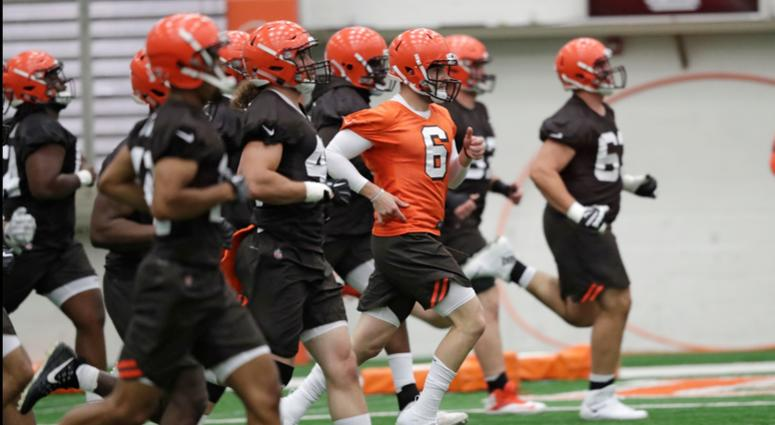 Cleveland Browns quarterback Baker Mayfield (6) runs a drill during rookie minicamp at the NFL football team's training camp facility in Berea, Ohio.
