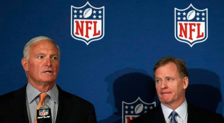 Cleveland Browns owner Jimmy Haslam speaks as NFL commissioner Roger Goodell looks on at right after they announced NFL team owners have reached agreement on a new league policy that requires players to stand for the national anthem or remain in the locke