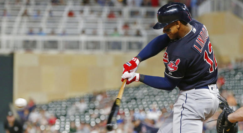 Cleveland Indians' Francisco Lindor hits a solo home run off Minnesota Twins pitcher Addison Reed during the eighth inning of a baseball game Thursday, May 31, 2018, in Minneapolis. Lindor went 4-for-5, including a three-run home run in the fourth inning.
