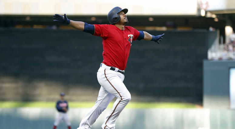 Minnesota Twins' Eduardo Escobar celebrates his three-run home run off Cleveland Indians pitcher Carlos Carrasco as he heads home during the first inning of a baseball game Friday, June 1, 2018, in Minneapolis.