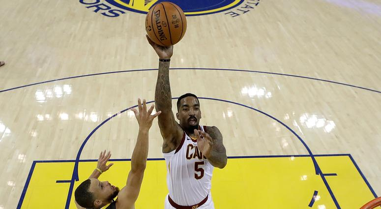 Cleveland Cavaliers guard J.R. Smith (5) shoots against Golden State Warriors guard Stephen Curry (30) and center JaVale McGee during the first half of Game 2 of basketball's NBA Finals in Oakland, Calif., Sunday, June 3, 2018