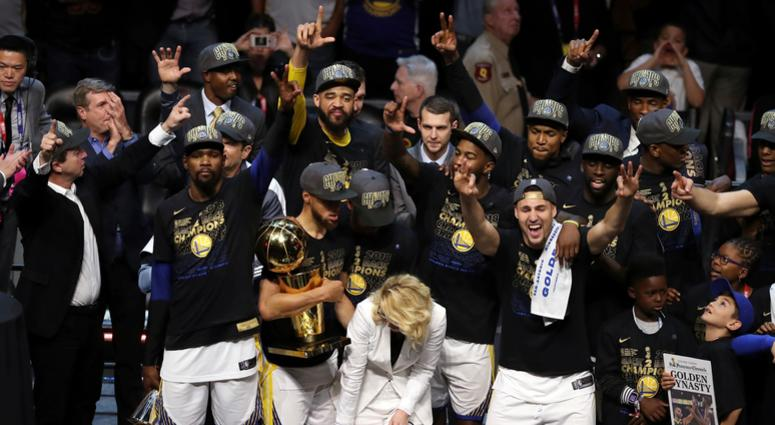 The Golden State Warriors celebrate after defeating the Cleveland Cavaliers 108-85 in Game 4 of basketball's NBA Finals to win the NBA championship, Friday, June 8, 2018, in Cleveland. (