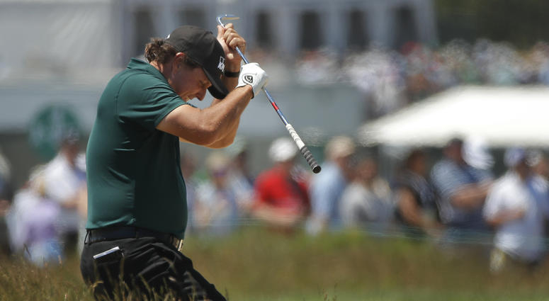 Phil Mickelson reacts to a shot from the fescue on the fifth hole during the third round of the U.S. Open Golf Championship, Saturday, June 16, 2018, in Southampton, N.Y.