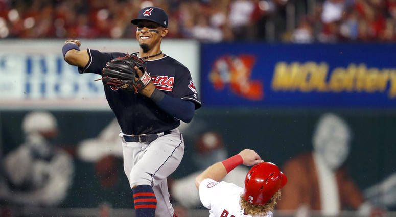 St. Louis Cardinals' Harrison Bader is out at second as Cleveland Indians shortstop Francisco Lindor, right, turns the double play during the second inning of a baseball game Monday, June 25, 2018, in St. Louis. The Cardinals' Kolten Wong was out at first