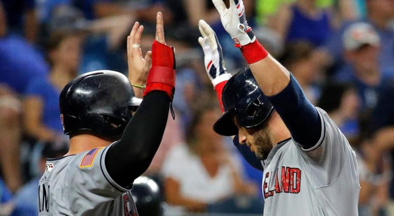 Cleveland Indians' Yan Gomes, right, celebrates with Yonder Alonso after Gomes hit a grand slam during the sixth inning of a baseball game against the Kansas City Royals on Tuesday, July 3, 2018, in Kansas City, Mo.