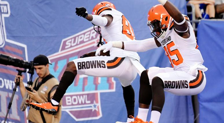 Cleveland Browns' David Njoku (85) celebrates with Rashard Higgins (81) after scoring a touchdown during the first half of a preseason NFL football game against the New York Giants, Thursday, Aug. 9, 2018, in East Rutherford, N.J.