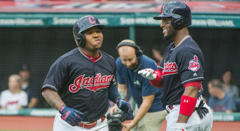 Cleveland Indians' Jose Ramirez is greeted by Yandy Diaz after hitting a two-run home run off Baltimore Orioles starting pitcher David Hess during the first inning of a baseball game in Cleveland, Friday, Aug. 17, 2018.