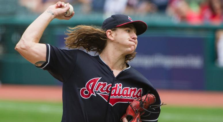 Cleveland Indians starting pitcher Mike Clevinger delivers to Minnesota Twins' Joe Mauer during the first inning of a baseball game in Cleveland, Thursday, Aug. 30, 2018.