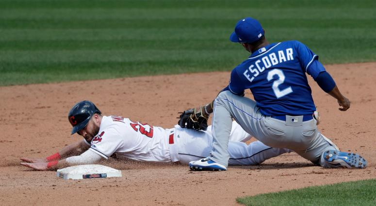 Cleveland Indians' Jason Kipnis slides safely into second base as Kansas City Royals' Alcides Escobar lets the ball get by in the sixth inning of a baseball game, Wednesday, Sept. 5, 2018, in Cleveland.