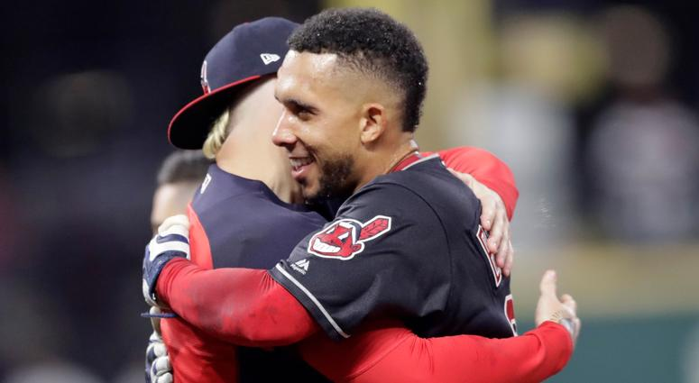 Cleveland Indians' Michael Brantley, right, hugs a teammate after hitting a winning RBI-single in the 11th inning of a baseball game against the Boston Red Sox, Saturday, Sept. 22, 2018, in Cleveland.