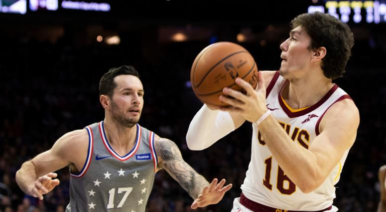 Cleveland Cavaliers' Cedi Osman looks to take the shot against Philadelphia 76ers' JJ Redick during the first half of an NBA basketball game in Philadelphia.