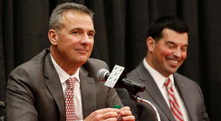 Ohio State NCAA college football head coach Urban Meyer, left, answers questions during a news conference announcing his retirement Tuesday, Dec. 4, 2018, in Columbus, Ohio. At right is assistant coach Ryan Day.