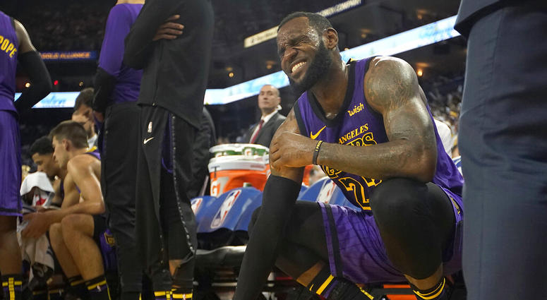 FILE -In this Dec. 25, 2018, file photo, Los Angeles Lakers forward LeBron James (23) reacts after straining his left groin during the second half of an NBA basketball game against the Golden State Warriors in Oakland, Calif. The Lakers say James likely w