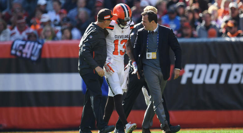 CLEVELAND, OH - OCTOBER 14: Rod Streater #13 of the Cleveland Browns is escorted offsides the field by medical staff in the first quarter against the Los Angeles Chargers at FirstEnergy Stadium on October 14, 2018 in Cleveland, Ohio.