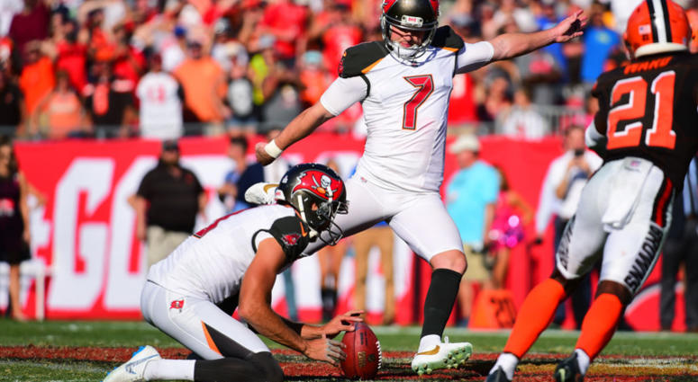 TAMPA, FL - OCTOBER 21: Chandler Catanzaro #7 of the Tampa Bay Buccaneers kicks the game-winning field goal in a 26-23 overtime win against the Cleveland Browns on October 21, 2018 at Raymond James Stadium in Tampa, Florida.(Photo by Julio Aguilar/Getty I