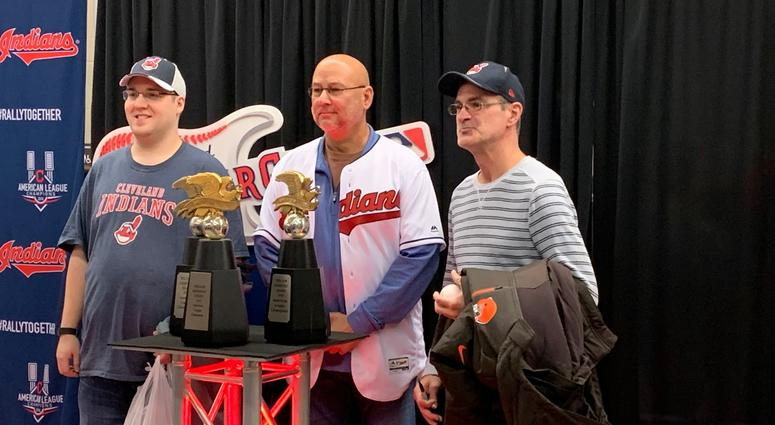 Terry Francona poses with two fans and the American League Championship Trophy