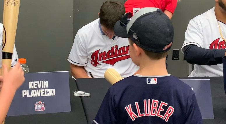 Trevor Bauer signs for a youngster